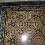 Antieke cementegels met cirkels